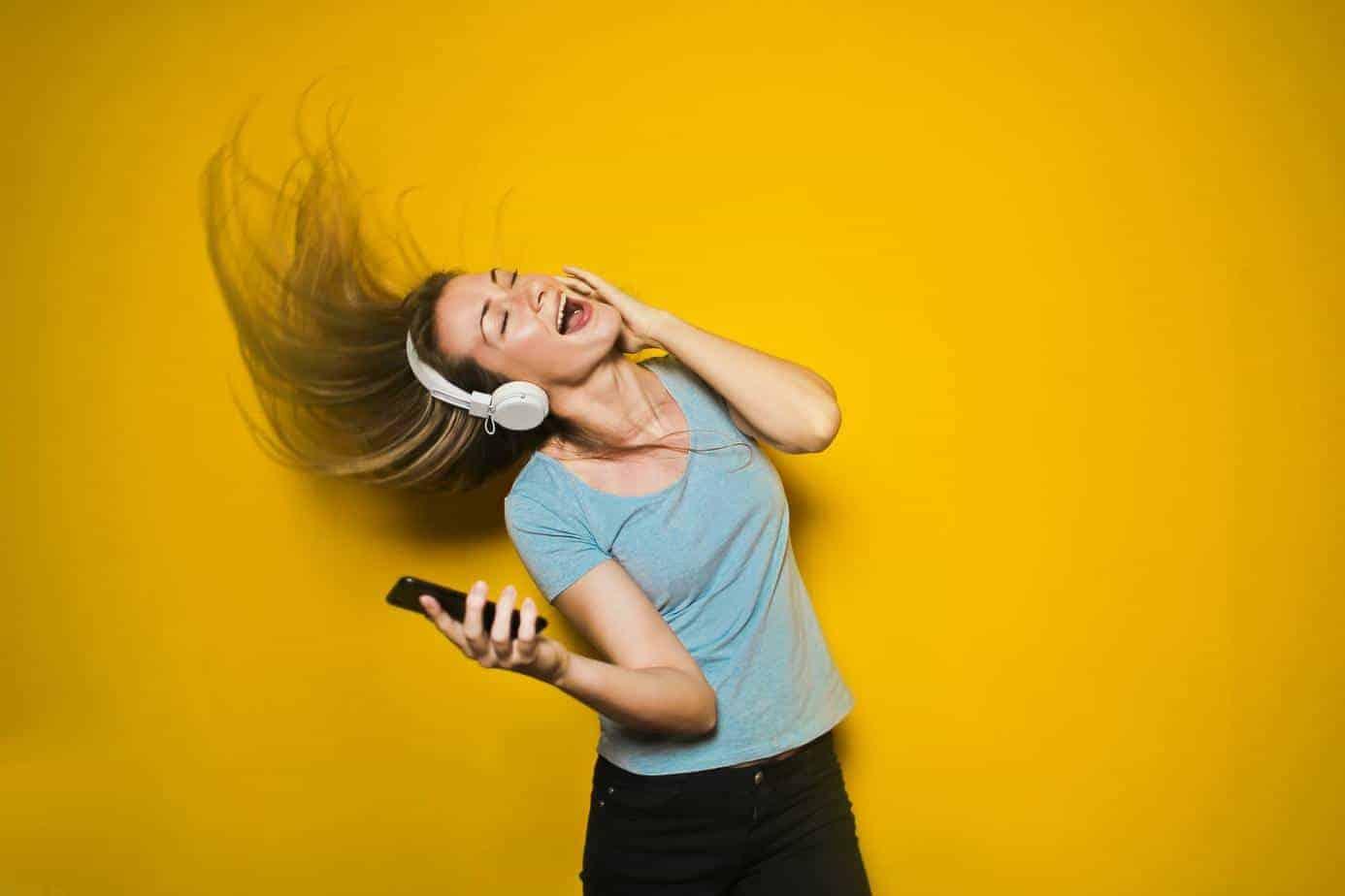 Girl rocking to music